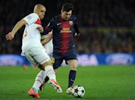 "Barcelona's Lionel Messi (R) and PSG's Alex Costa are pictured during their Champions League match on April 10, 2013. ""Messi was the catalyst. We changed after he came on and we have to thank him for that,"" teammate Pedro Rodriguez said"