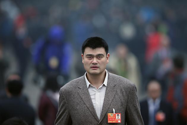 BEIJING, CHINA - MARCH 12: Delegate Yao Ming (C), a former NBA basketball star, leaves the Great Hall of the People after attending the closing session of the annual Chinese People's Political Consultative Conference (CPPCC) on March 12, 2013 in Beijing, China. The newly-elected Chairman of the CPPCC Yu Zhengsheng pledged Tuesday that China will not copy Western political systems under any circumstances. (Photo by Feng Li/Getty Images)
