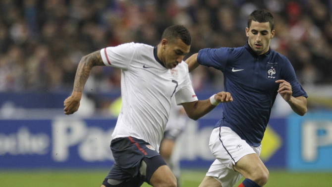 US Danny Williams , left, triples past France's Maxim Gonalons during a friendly soccer match France against the USA at Parc des Princes stadium in Saint Denis, Friday, Nov. 11, 2011. France won 1-0.(AP Photo/Michel Euler)