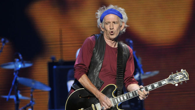 "Keith Richards of the Rolling Stones performs on the kick-off of the band's ""50 and Counting"" tour at the Staples Center on Friday, May 3, 2013 in Los Angeles. (Photo by Chris Pizzello/Invision/AP)"