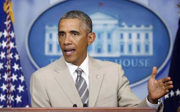 U.S. President Barack Obama answers questions in the White House Press Briefing Room.