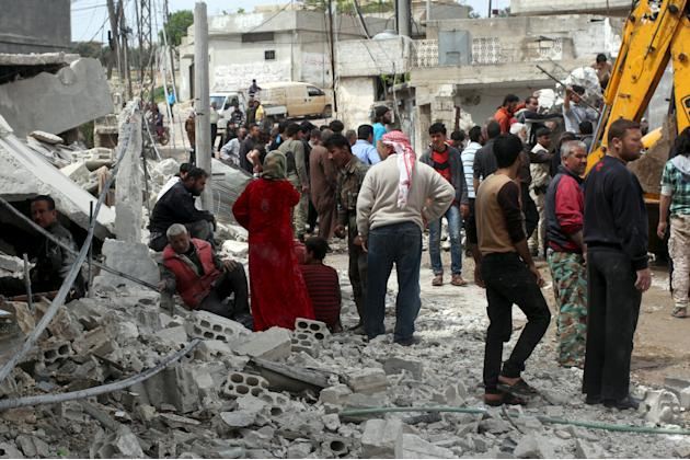 Civilians react as others search for survivors at a site hit by what activists said was an airstrike by forces loyal to Syria's President Bashar al-Assad in Jusef village, in the Jabal al-Zawiya r