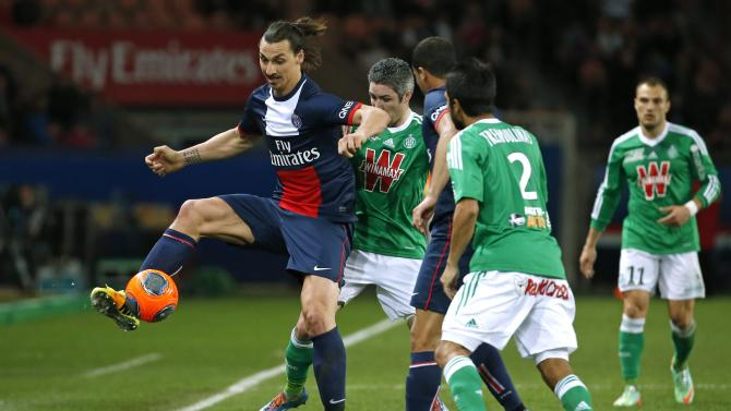 Paris St Germain's Zlatan Ibrahimovic challenges St Etienne's Loic Perrin and Benoit Tremoulinas during their French Ligue 1 soccer match at the Parc des Princes Stadium in Paris