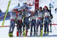 Alpine Skiing - FIS Alpine Skiing World Championships - Alpine Team Event - St. Moritz, Switzerland - 14/2/17 - (L to R) France's Julien Lizeroux, Tessa Worley, Alexis Pinturault, Adeline Baud Mugnier, Mathieu Faivre and Nastasia Noens celebrate winning gold after the final of the parallel slalom Mixed Team event. REUTERS/Denis Balibouse