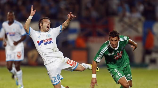 Saint Etienne's Clement challenges Olympique Marseille's Valbuena during French Ligue 1 soccer match in Marseille