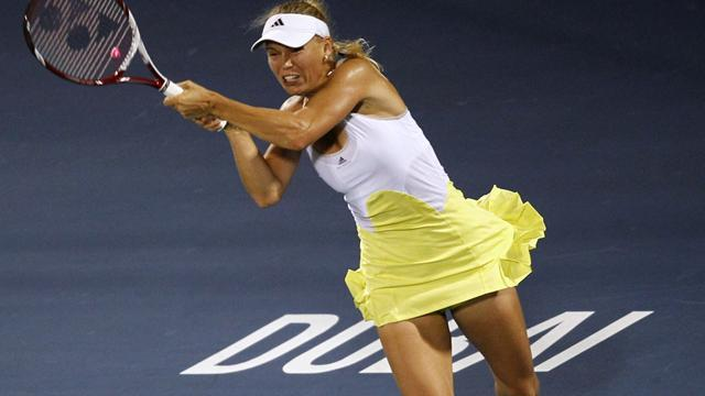 Tennis - Wozniacki storms into second round in Dubai