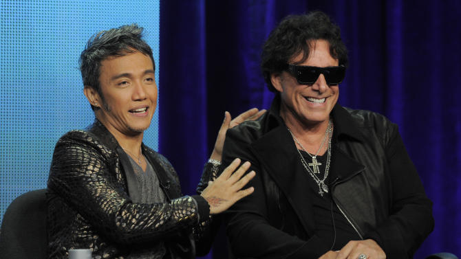 "Arnel Pineda, left, and Neal Schon of the rock band Journey take part in a panel discussion on the Independent Lens documentary ""Don't Stop Believin': Everyman's Journey,"" at the PBS Summer 2013 TCA press tour at the Beverly Hilton Hotel on Tuesday, Aug. 6, 2013, in Beverly Hills, Calif. (Photo by Chris Pizzello/Invision/AP)"