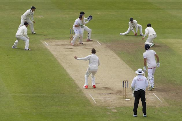New Zealand's Mark Craig, centre, looks on as teammate  Kane Williamson, upper right, catches England's Ian Bell, upper centre, for 1 on the fifth day of the second Test match between England