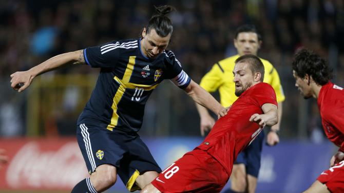 Sweden's Zlatan Ibrahimovic fights for the ball with Turkey's Caner Erkin during their international friendly soccer match at 19 Mayis Stadium in Ankara