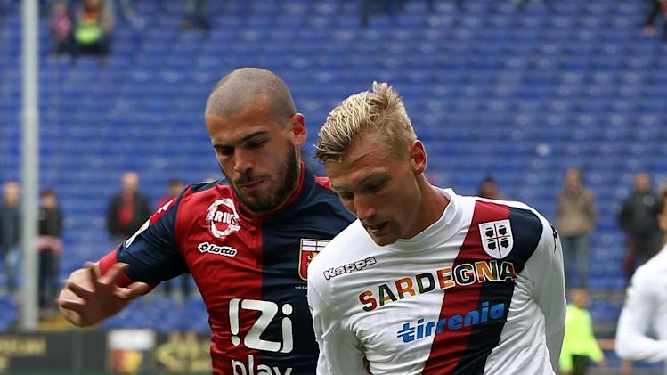 Genoa's Stefano Sturaro, left, vies for the ball with Cagliari's Sebastian Eriksson of Sweden during a Serie A soccer match between Genoa and Cagliari, at the Genoa Luigi Ferraris Stadium, Italy, Saturday, April 19, 2014