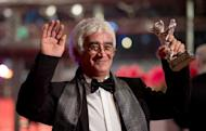 "Iranian director Kamboziya Partovi shows his Silver Bear for Best Script after the awards ceremony of the 63rd Berlinale Film Festival on February 16, 2013 in Berlin. Partovi won the Silver Bear for Best Script for the film ""Parde"" he codirected with Jafar Panahi"
