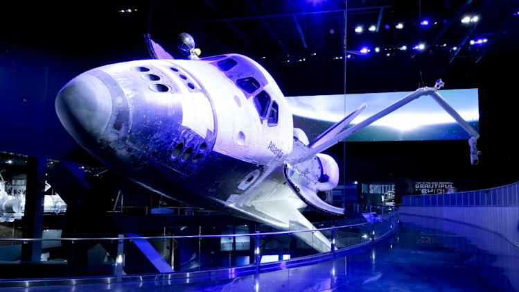 This June 20, 2013 photo shows space shuttle Atlantis on display at the Kennedy Space Center Visitor Complex in Cape Canaveral, Fla. The 900,000 square-foot facility centering around Atlantis will open to the public June 29. (AP Photo/John Raoux)