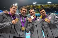 (L-R) US swimmers Conor Dwyer, Michael Phelps, Ryan Lochte, Ricky Berens poses on the podium with their gold medals after winning the men's 4x200m freestyle relay final during the swimming event at the London 2012 Olympic Games on July 31, 2012 in London. AFP PHOTO / FABRICE COFFRINI