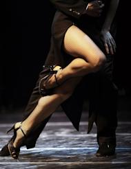An Argentine couple dance during a semi-final at the Tango Dance World Championship in Buenos Aires on August 28, 2010. Some health centers in Buenos Aires are finding tango can help mental wellbeing
