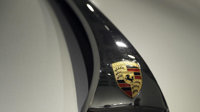 In this photo taken Wednesday, Oct. 9, 2013, details of the hood of a 1964 Porsche Type 356C Carrera 2 Couple is seen in the Porsche By Design Seducing Speed exhibit at the North Carolina Museum of Art in Raleigh, N.C. (AP Photo/Gerry Broome)