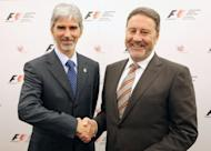 Silverstone's managing director Richard Phillips (right) shakes hands with Damon Hill,president of The British Racing Drivers Club, which owns Silverstone, at a press conference in central London in 2009. Phillips has vowed to carry on in his job as the circuit started counting the cost of last weekend's rain-marred British Grand Prix