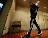 Real Madrid's Portuguese coach Jose Mourinho leaves after a press conference at Santiago Bernabeu stadium in Madrid on April 2, 2013, on the eve the Champions League football match Real Madrid CF vs AS Galatasaray