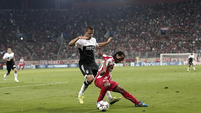Olympiakos' Leandro Salino right is challenged by Benfica's Lima during a Champions League group C soccer match between Olympiakos and Benfica at Karaiskaki stadium, in Piraeus, near Athens, on Tuesday, Nov. 5, 2013