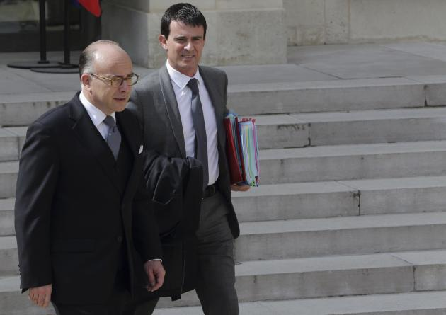 French Prime Minister Valls and Interior Minister Cazeneuve leave the Elysee Palace in Paris