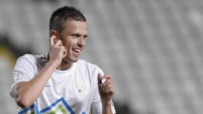 Josip Ilicic of Slovenia celebrates his goal against Cyprus during their World Cup group E qualifying soccer match at GSP stadium in Nicosia, Cyprus, Tuesday, Sept. 10, 2013