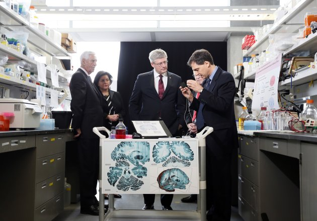 Canadian Prime Minister Stephen Harper tours a research lab in Montreal.