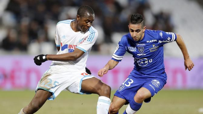 Bastia's Boudebouz challenges Olympique Marseille's Imbula during their French Ligue 1 soccer match at the Velodrome stadium in Marseille