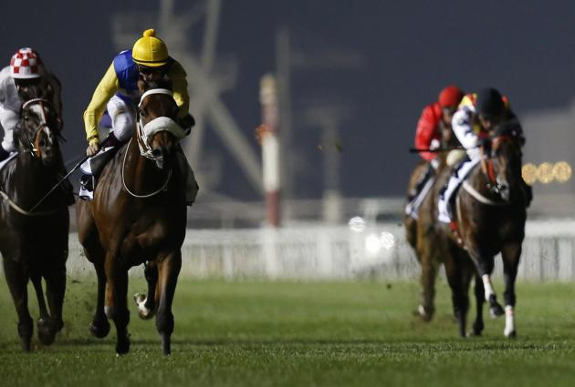 "Soumillon, riding Shea Shea of South Africa, races towards the finish line during the fifth race ""Al Quoz Sprint"" of the Dubai World Cup at the Meydan Racecourse in Dubai"