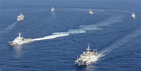 Vessels from the China Maritime Surveillance and the Japan Coast Guard are seen near disputed islands, called Senkaku in Japan and Diaoyu in China, in the East China Sea, in this photo taken by Kyodo September 10, 2013. Mandatory Credit. REUTERS/Kyodo
