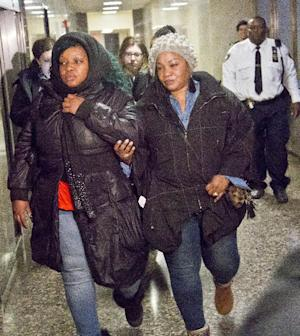 Leslie Pollard, left, is escorted from court after…