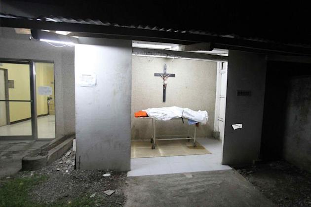 A body lies in a morgue at a hospital in Cebu, central Philippines on August 17, 2013