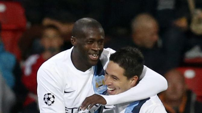 Manchester City's Toure and Nasri celebrate Toure's goal against Viktoria Plzen during their Champions League group D soccer match at the Doosan Arena in Prague