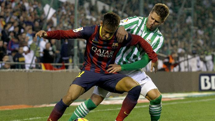 Barcelona's Neymar from Brazil, left, and Betis' Markus Steinhofer from Germany, right, fight for the ball during their La Liga soccer match at the Benito Villamarin stadium, in Seville, Spain, Sunday, Nov 10, 2013