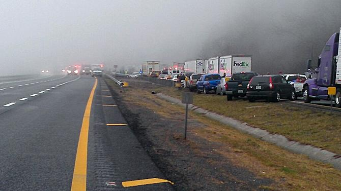 This image provided by WXII Channel 12 news,  shows the scene following a 75-vehicle pileup on Interstate 77 near the Virginia-North Carolina border in Galax, Va., on Sunday, March 31, 2013. Virginia State Police say three people have been killed and more than 20 are injured and traffic is backed up about 8 miles. (AP Photo/WXII, William Bottomley) MANDAORY CREDIT: WXII,WILLIAM BOTTOMLEY