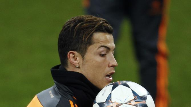 Real Madrid's Cristiano Ronaldo controls a ball during a training session in Gelsenkirchen