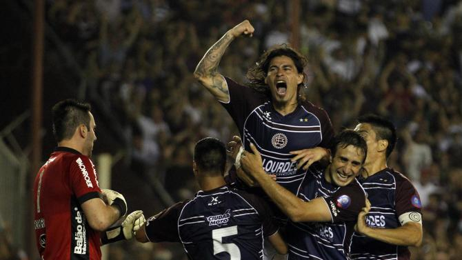 Blanco of Argentina's Lanus and his teammates celebrate after scoring a goal against Brazil's Ponte Preta during the second leg of the final Copa Sudamericana soccer match in Buenos Aires