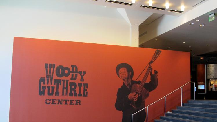 "This April 25, 2013, photo shows the entrance to the Woody Guthrie Center, which opens to the public on Saturday in downtown Tulsa. The center features interactive exhibits chronicling the Oklahoma folk singer's life and career, as well as an original, handwritten copy of ""This Land is Your Land."" (AP Photo/Justin Juozapavicius)"