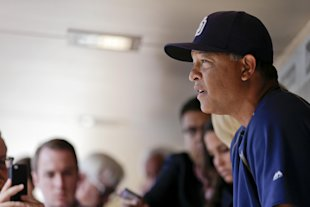 Dave Roberts is expected to replace Don Mattingly in L.A. (AP Photo/Gregory Bull)