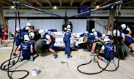 Members of Williams Formula One team practice pit stop ahead of the Brazilian F1 Grand Prix in Sao Paulo, Brazil, November 12, 2015. REUTERS/Paulo Whitaker