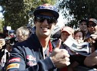 Toro Rosso Formula One driver Daniel Ricciardo of Australia gives a thumb up as he arrives at the Albert Park circuit for the third practice session of the Australian F1 Grand Prix in Melbourne March 17, 2012. REUTERS/Brandon Malone/Files