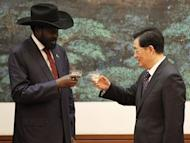 Chinese President Hu Jintao (R) and South Sudan President Salva Kiir toast after a signing ceremony at the Great Hall of the People in Beijing. South Sudan's leader accused Sudan of declaring war on Tuesday as Khartoum's warplanes bombed border regions in defiance of international calls for restraint