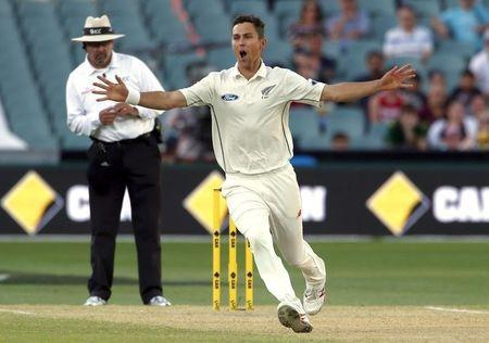 New Zealand's Trent Boult celebrates after he dismissed Australia's Adam Voges for 28 runs during the third day of the third cricket test match at the Adelaide Oval, in South Australia
