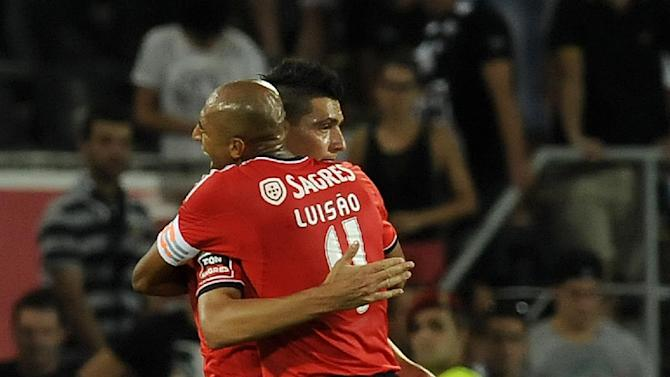 Benfica's Luisao, right, celebrates with Oscar Cardozo, left, after their victory over Vitoria Guimaraes in a Portuguese League soccer match at D. Afonso Henrique stadium in Guimaraes, Portugal, Sunday, Sept. 22, 2013. Cardozo scored the only goal in Benfica's 1-0 victory