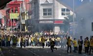 This file photo shows protesters challenging police during an anti-government rally in Kuala Lumpur, on April 28. A Malaysian court has charged two policemen for assaulting a photographer who was covering the rally, according to a lawyer