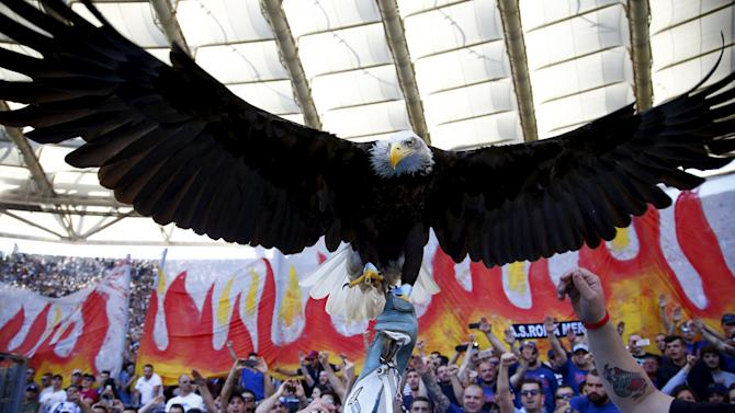A trainer holds Lazio's mascot, a white headed eagle called Olimpia before their Serie A soccer match against AS Roma at the Olympic stadium in Rome