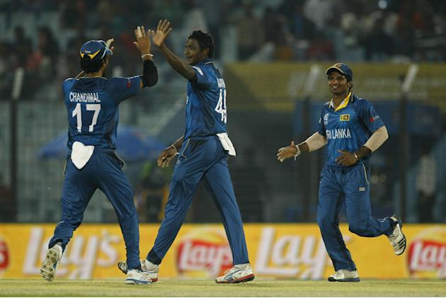 Sri Lanka's Ajantha Mendis, center, celebrates with his teammates the wicket of Netherlands' Ahsan Malik during their ICC Twenty20 Cricket World Cup match in Chittagong, Bangladesh, Monday, Ma