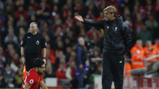 Liverpool manager Juergen Klopp and Emre Can