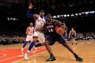 Carmelo Anthony (L) of the New York Knicks and Ivan Johnson of the Atlanta Hawks during their NBA game on February 22. Anthony contributed 15 points