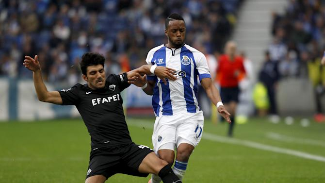 Porto's Hernani Fortes fights for the ball with Academica's Ricardo Esgaio  during their Portuguese Premier League soccer match at Dragao stadium in Porto