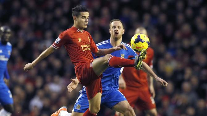 Liverpool's Coutinho is challenged by Hull City's Meyler during their English Premier League soccer match at Anfield in Liverpool