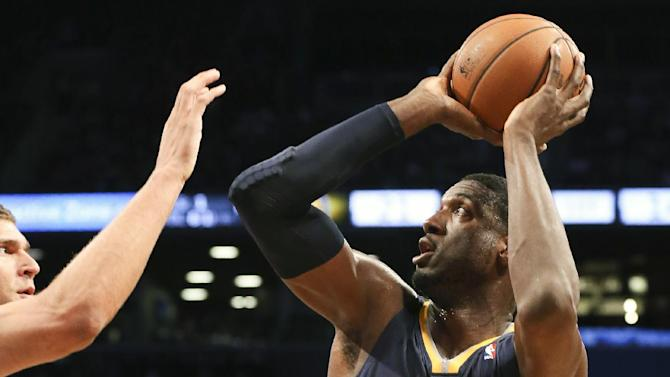 Indiana Pacers center Roy Hibbert (55) looks to shoot the ball during the first quarter of an NBA basketball game, Saturday, Nov. 9, 2013, at the Barclays Center in New York